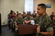 """U.S. Marine Corps Lt.Col. James C. Paxton and Sgt.Maj. Fabian Casillas the commanding officer and sergeant major of Marine Corps Air Station (MCAS) Yuma's Headquarters & Headquarters Squadron (H&HS) welcome the new Marines and Sailors assigned to H&HS during a Welcome Aboard brief at MCAS Yuma, Ariz., June 12, 2019. The H&HS """"Guardians"""" are responsible for all day-to- day operations on the air station, with approximately 800 Marines and Sailors are assigned to the Squadron, as well as around 1,200 civilians who work on the air station. (U.S. Marine Corps photo by Lance Cpl. John Hall)"""