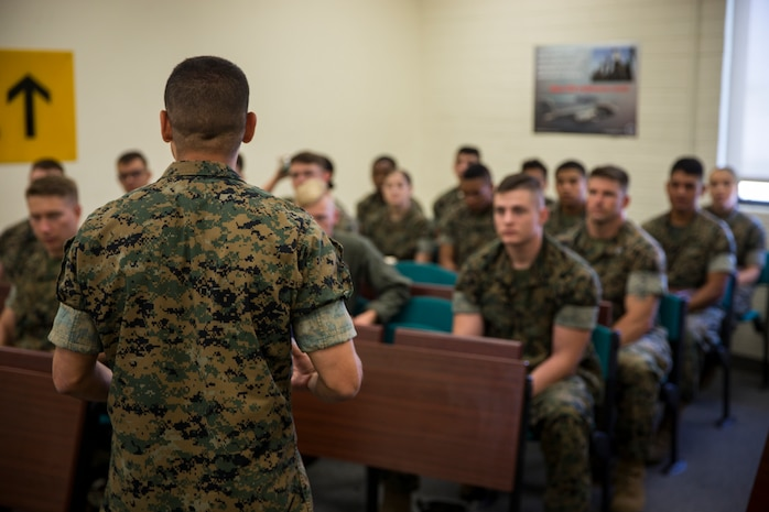 "U.S. Marine Corps Lt.Col. James C. Paxton and Sgt.Maj. Fabian Casillas the commanding officer and sergeant major of Marine Corps Air Station (MCAS) Yuma's Headquarters & Headquarters Squadron (H&HS) welcome the new Marines and Sailors assigned to H&HS during a Welcome Aboard brief at MCAS Yuma, Ariz., June 12, 2019. The H&HS ""Guardians"" are responsible for all day-to- day operations on the air station, with approximately 800 Marines and Sailors are assigned to the Squadron, as well as around 1,200 civilians who work on the air station. (U.S. Marine Corps photo by Lance Cpl. John Hall)"