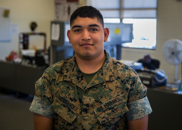 U.S. Marine Corps Lance Cpl. Jonathan Hernandez, a flight dispatcher with Base Operations Marine Corps Air Station (MCAS) Yuma's Headquarters & Headquarters Squadron (H&HS) poses for a photograph at MCAS Yuma, Ariz., June 12, 2019. As a flight dispatcher, Hernandez is responsible for the preparation of operation plans and orders and compiling data for and preparing operations and aviation safety reports. (U.S. Marine Corps photo by Lance Cpl. John Hall)