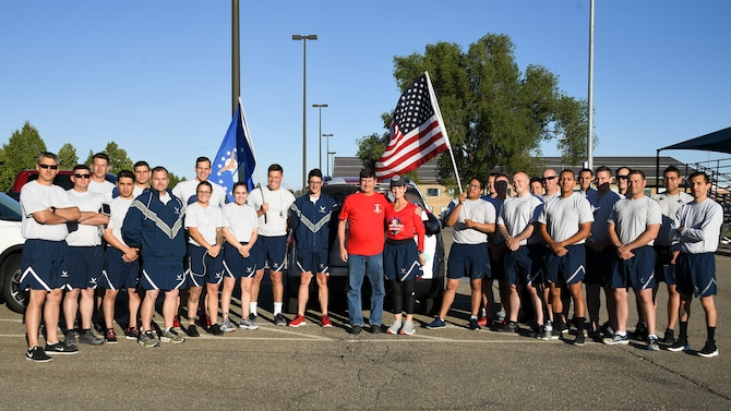 "Gold Star Mother Cathy Powers with her ""AMMO family"" June 21, 2019, at Hill Air Force Base, Utah. Munitions Airmen assigned to the 388th and 419th Fighter Wings and the 649th Munitions Squadron ran a 5K with Cathy whose son, Senior Airman Bryce Powers, passed away April 26, 2013, after a vehicle accident in Japan. Cathy's goal is to run a total of 1,000 miles while visiting all 50 states to raise funds to sponsor veteran's wreaths to be placed at Arlington National Cemetery in December. (U.S. Air Force photo by R. Nial Bradshaw)"