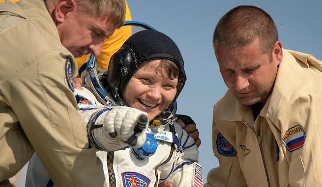 U.S. Army astronaut Lt. Col. Anne McClain exits the Soyuz MS-11 spacecraft minutes after she, Canadian Space Agency astronaut David Saint-Jacques, and Roscosmos cosmonaut Oleg Kononenko, land back on Earth June 24 (U.S. Eastern time). McClain returns after 204 days in space where she served as a member of the Expedition 58 and 59 crew onboard the International Space Station. (NASA photo by Bill Ingalls)