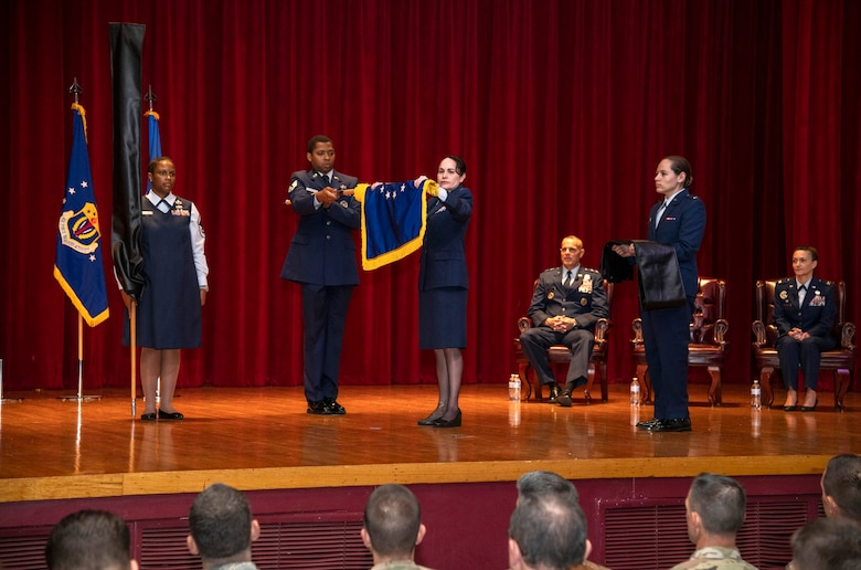 Brig. Gen. Alice Trevino, commander of the newly named Air Force Installation Contracting Center, furls her unit's old Air Force Installation Contracting Agency flag at a special ceremony June 25, 2019, on Joint Base San Antonio-Lackland, Texas. The Air Force Installation and Mission Support Center formally redesignated AFICC and the Air Force Services Center -- two of its primary subordinate units -- during a formal ceremony to bring them in line with Air Force naming conventions. (U.S. Air Force photo by Johnny Saldivar)