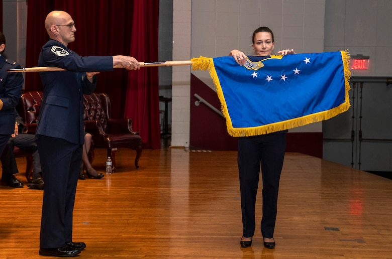 Col. Donna Turner, commander of the newly named Air Force Services Center, unfurls her unit's new flag at a special ceremony June 25, 2019, on Joint Base San Antonio-Lackland, Texas. The Air Force Installation and Mission Support Center formally redesignated AFSVC and the Air Force Installation Contracting Center-- two of its primary subordinate units -- to bring them in line with Air Force naming conventions. (U.S. Air Force photo by Johnny Saldivar)