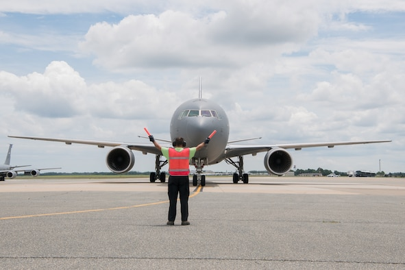 A KC-46A Pegasus belonging to the 344th Air Refueling Squadron is marshalled onto a parking spot after landing June 25, 2019, at Dover Air Force Base, Del. This was the first time a KC-46A has visited Dover AFB. (U.S. Air Force Photo by Mauricio Campino)