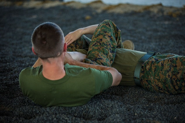 U.S. Marines stationed at Marine Corps Air Station (MCAS) Yuma, practice Marine Corps Martial Arts Program (MCMAP) techniques at MCAS Yuma, Ariz., June 18, 2019. MCMAP is a combat system developed by the United Stated Marine Corps to combine martial arts techniques with morale and team-building functions and instructions in the warrior ethos that Marines should embody. (U.S. Marine Corps photo by Lance Cpl. Hall)
