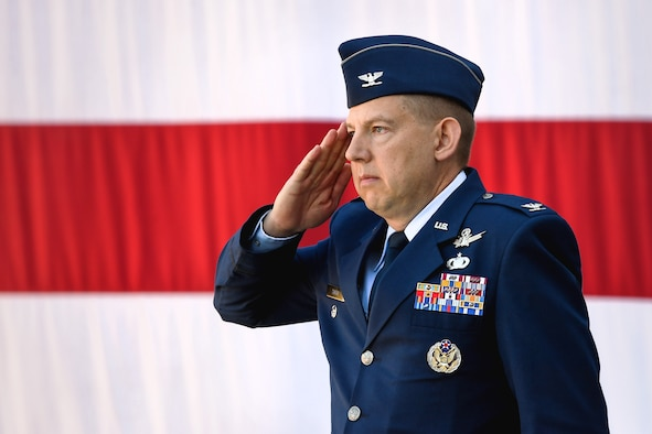 Col. James Smith, 50th Space Wing commander, renders his first salute as commander of the wing during a change of command ceremony in front of the DeKok building at Schriever Air Force Base, Colorado, June 24, 2019. The 50th SW is responsible for 185 communications, navigation and surveillance satellites and is geographically spread across the world in 14 operating locations. (U.S. Air Force photo by Kathryn Calvert)