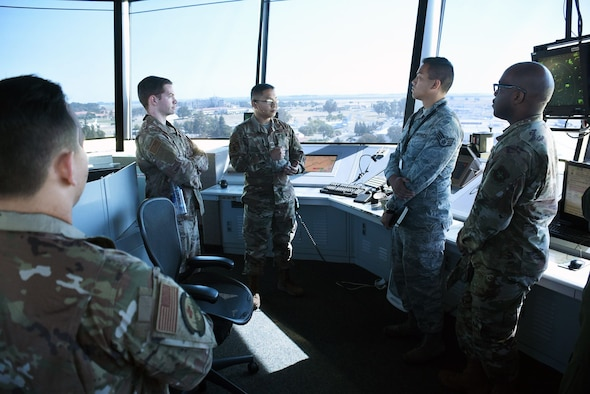 U.S. Air Force Airmen from the 60th Operations Support Squadron show participants of an Airman enrichment day the normal tasks carried out by air traffic control tower personnel on a daily basis June14, 2019, at Travis Air Force Base, California. The Airman enrichment day was the first of its kind in the Air Force and exposed Airmen of different units to the jobs and mission contributions of other Air Force jobs. (U.S. Air Force photo by Senior Airman Christian Conrad)