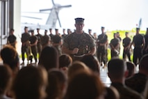 U.S. Marine Corps Lt. Col. Brian Ashford, former commanding officer of Headquarters and Headquarters Squadron, delivers a speech during a change of command ceremony June 21, 2019 at Marine Corps Air Station Futenma, Okinawa, Japan. Ashford relinquished his duties as Headquarters and Headquarters Squadron commanding officer to U.S. Marine Corps Lt. Col. Eric Starr. (U.S. Marine Corps photo by Lance Cpl. Savannah Mesimer)