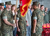 U.S. Marine Corps Lt. Col. Brian Ashford holds the Marine Corps flag during a change of command ceremony June 21, 2019 at Marine Corps Air Station Futenma. The change of command ceremony was held in honor of Ashford relinquishing his duties as commanding officer of Headquarters and Headquarters Squadron, Marine Corps Installations Pacific, to Lt. Col. Eric Starr. (U.S. Marine Corps photo by Lance Cpl. Savannah Mesimer)