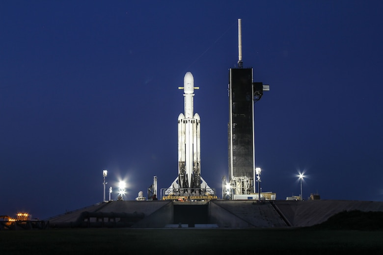 Sporting two, previously used side boosters, the SpaceX Falcon Heavy launch vehicle stands tall on Launch Complex-39A at NASA's Kennedy Space Center in the early morning hours of June 24, 2019. The four-hour launch window opens tonight at 11:30 p.m. Eastern, 8:30 p.m. Pacific. (Photo: SpaceX)