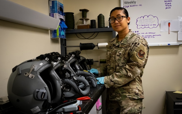 Airman 1st Class Samira Trimas, Aircrew Flight Equipment technician assigned to the 353rd Special Operations Support Squadron, poses for a photo on Kadena Air Base, June 25, 2019.