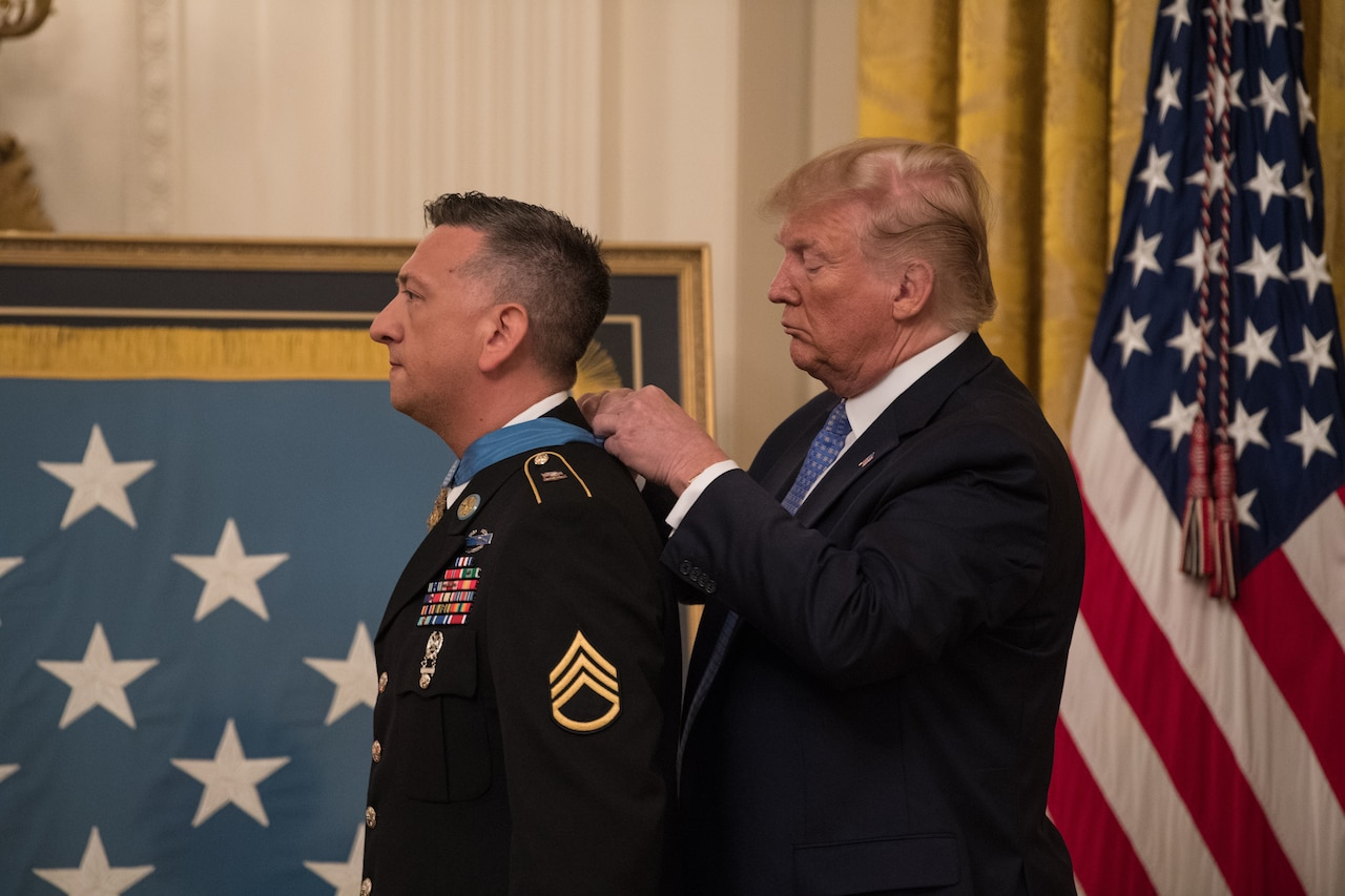President Donald J. Trump presents the Medal of Honor to former Army Staff Sgt. David G. Bellavia.