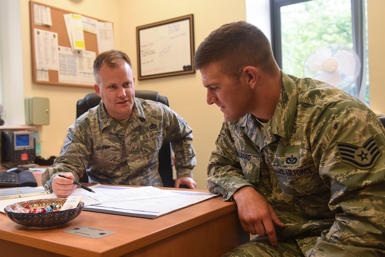 U.S. Air Force Master Sgt. Curtis L. Brown, 100th Force Support Squadron career assistance advisor, speaks with Staff Sgt. William E. Baynard, 100th Civil Engineer Squadron pavements and equipment craftsman, about career options at RAF Mildenhall, England, June 12, 2019. Brown counsels Airmen on retraining, reenlistment, separation, military benefits and commissioning opportunities. (U.S. Air Force photo by Airman 1st Class Joseph M. Barron)