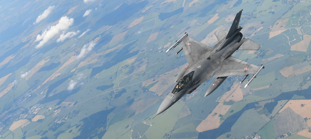 A Polish air force F-16 Fighting Falcon flies beside a U.S. Air Force KC-135 Stratotanker during aerial refueling in support of Exercise Baltic Operations over Germany, June 19, 2019. The BALTOPS Exercise is a U.S. exercise focused on joint interoperability in the Baltic Region, planned and executed this year by the U.S. and NATO. (U.S. Air Force photo by Senior Airman Alexandria Lee)
