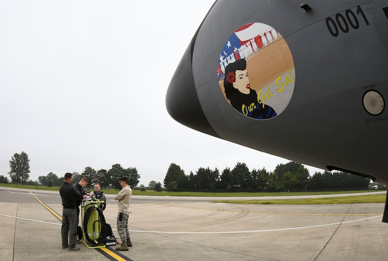 Airmen assigned to the 100th Air Refueling Wing, RAF Mildenhall, England, review a pre-flight checklist prior to refueling training in support of Exercise Baltic Operations, at RAF Mildenhall, England, June 19, 2019. The BALTOPS Exercise is the premier annual maritime-focused exercise in the Baltic Region. (U.S. Air Force photo by Senior Airman Alexandria Lee)