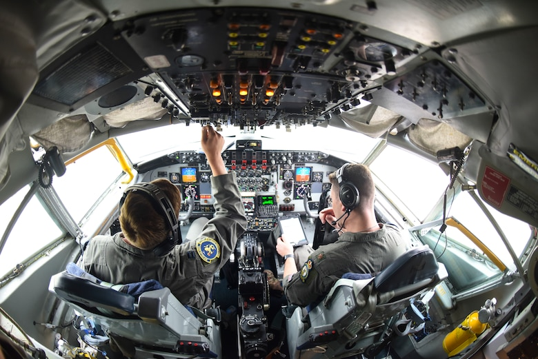 U.S. Air Force Maj. Patrick Hanson and Capt. Brendan Keiper, 351st Air Refueling Squadron pilots,perform a preflight checklist before a training mission supporting Exercise Baltic Operations at RAF Mildenhall, England, June 19, 2019. BALTOPS is an exercise involving approximately 11,600 maritime, ground and air force personnel from 18 countries. (U.S. Air Force photo by Airman 1st Class Joseph Barron)