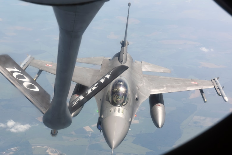 A Polish air force F-16 Fighting Falcon approaches a U.S. Air Force KC-135 Stratotanker assigned to the 351st Air Refueling Squadron at RAF Mildenhall, England, to receive fuel over Germany, June 19, 2019. The refueling was part of Exercise Baltic Operations, a U.S.-led exercise focused on joint interoperability. (U.S. Air Force photo by Airman 1st Class Joseph Barron)