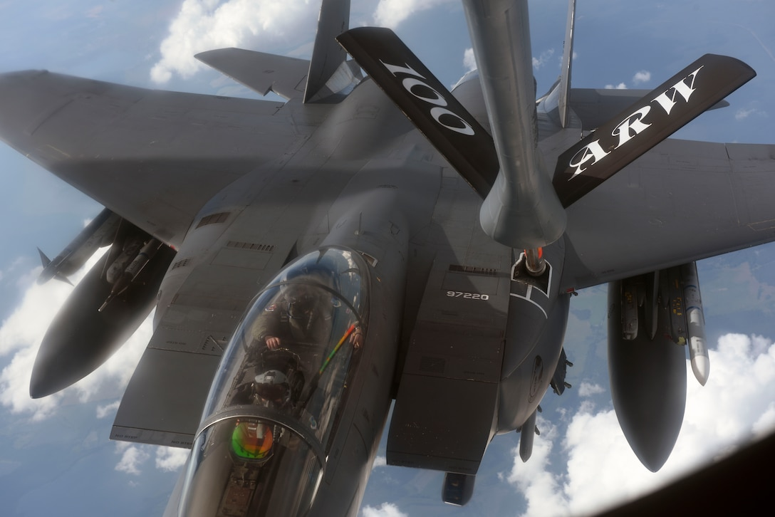 A U.S. Air Force F-15E Strike Eagle assigned to the 492nd Fighter Squadron at RAF Lakenheath, England, receives fuel over Germany from a KC-135 Stratotanker assigned to the 351st Air Refueling Squadron at RAF Mildenhall, England, June 19, 2019. The refueling was part of the annual Baltic Operations exercise which began in 1972 and is now in its 47th year. (U.S. Air Force photo by Airman 1st Class Joseph Barron)