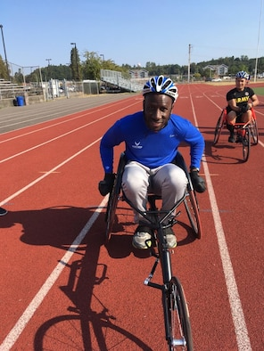 U.S. Air Force Staff Sgt. Patrick Sims, Sexual Assault Prevention and Response volunteer victim advocate, practices for a wheelchair race at Joint Base Lewis-McChord, Washington, Aug. 28, 2018.