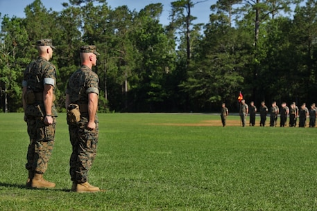 U.S. Marine Corps Lt. Col. Robert P. Gerbracht, left, and Lt. Col. Patrick G. Manson, right, commanding officer of 8th Engineer Support Battalion, 2nd Marine Logistics Group, stand at attention during a change of command ceremony at Camp Lejeune, North Carolina, June 19, 2019. During the ceremony, Manson relinquished command of 8th ESB to Gerbracht