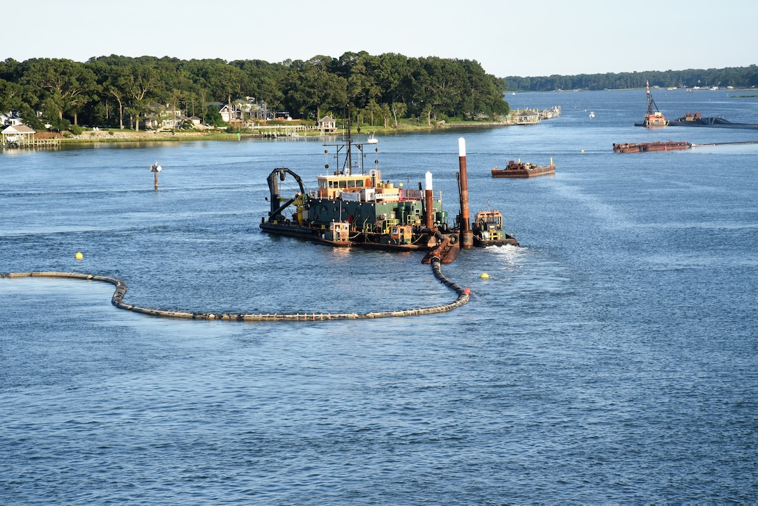 A dredge pipeline floats out before submerging behind the hydraulic cutter head dredge, as it positions to begin a cut in the turning basin of the Lynnhaven Inlet Federal Navigation Project, Virginia Beach, Virginia.