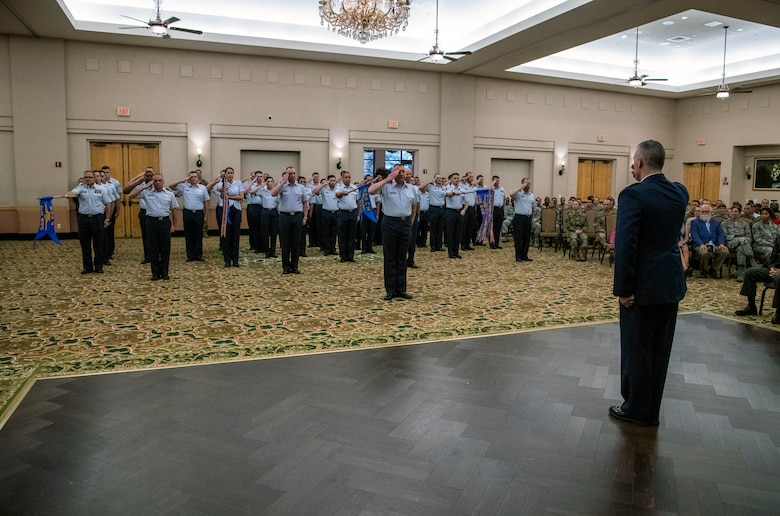 """Col. Eric DeLange, 688th Cyberspace Wing commander, renders a """"final salute"""" to 688th CW Airmen during the wing's change of command ceremony at Joint Base San Antonio-Lackland, Texas, on June 25, 2019. Col. Steven Anderson took command of the 688th CW during the ceremony. (U.S. Air Force photo by Johnny Saldivar)"""