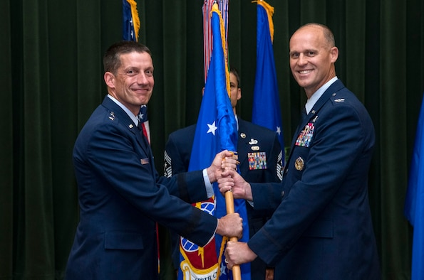 Col. Steven Anderson (right) accepts command of the 688th Cyberspace Wing from Maj. Gen. Robert Skinner, 24th Air Force commander, during the wing's change of command ceremony at Joint Base San Antonio-Lackland, Texas, on June 25, 2019. Col. Eric DeLange relinquished command of the 688th CW during the ceremony. (U.S. Air Force photo by Johnny Saldivar)