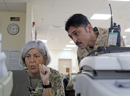 U.S. Army Capt. Theresa Terry, 349th Combat Support Hospital, shows computer systems to Awadh Hamoud, a Kuwait Army nurse, at Camp Arifjan's U.S. Military Hospital – Kuwait June 17, 2019.