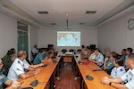 Hawaii National Guard medical personnel along with counterparts from the Indonesian Armed Forces, receive an intro brief during a visit to the Republic of Indonesia Center for Health Crisis Jun. 17, 2019, Jakarta, Indonesia. The tour of the health center was a kick-off event of a Subject Matter Expert Exchange between the Hawaii Air National Guard and Tentara Nasional Indonesia. The SMEE was part of the State Partnership Program which links a state's National Guard with a partner nation in support of mutual interests. The program is held to foster positive relations and to build capacity with partner countries.