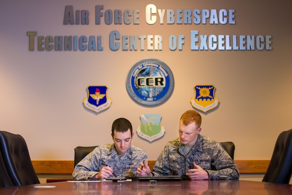 Left to right, Capt. Seth Martin 2nd Lt. Landon Tomcho, earned master's degrees in cyber operations and computer science from AFIT in 2019 (U.S. Air Force photo/Bruce Lambert)