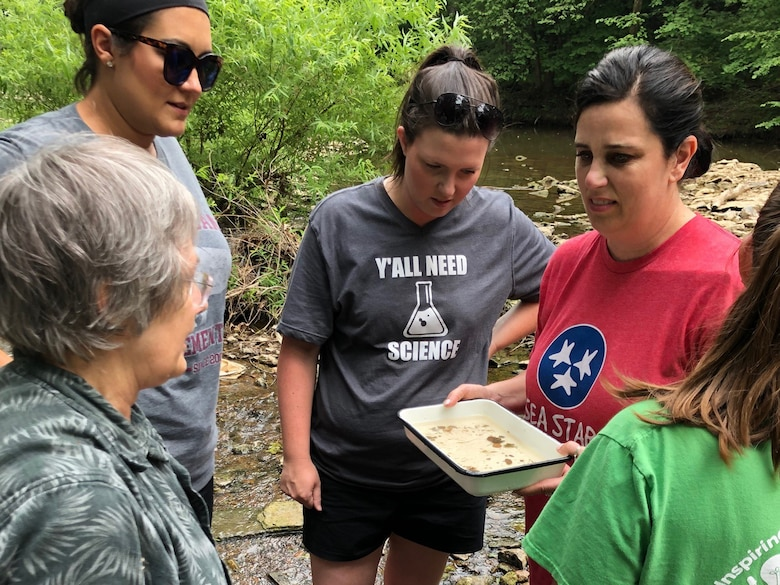 Joy Broach (Left), U.S. Army Corps of Engineers Nashville District biologist, assists Sumner County teachers with collecting aquatic invertebrate samples June 5, 2019 from Drakes Creek in Hendersonville, Tenn. These educators were participating in a teacher externship opportunity to develop STEM curriculum in partnership with the Corps of Engineers. (Courtesy Photo)