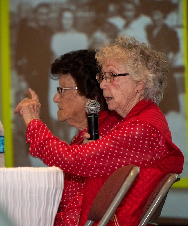 Marian Sousa, 93, draftsman from 1943-1945, delivers remarks during a base visit June 25, 2019, at Travis Air Force Base, California. Wynn, one of the original Rosie the Riveters, was at Travis AFB to share experiences with female maintainers assigned to the 60th Maintenance Group. Used in movies, newspapers, posters, photographs and articles, the Rosie the Riveter campaign stressed the patriotic need for women to enter the workforce during World War II. Though women filled many positions during the war, the aviation industry saw the greatest increase in female workers. (U.S. Air Force photo by Heide Couch)