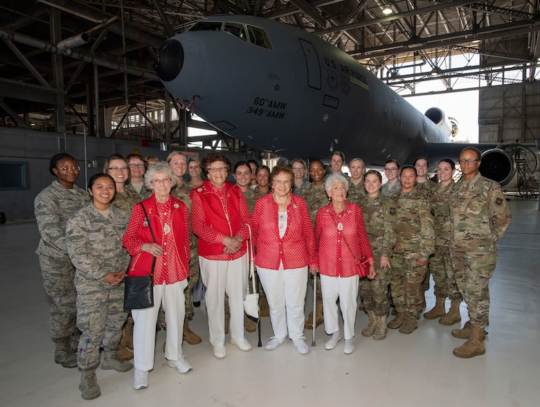 U.S. Air Force Airmen pose with members of the original Rosie the Riveters June 25, 2019, at Travis Air Force Base, California. The Rosies, who are all in their 90s, were at Travis AFB to share experiences with female maintainers assigned to the 60th Maintenance Group. Used in movies, newspapers, posters, photographs and articles, the Rosie the Riveter campaign stressed the patriotic need for women to enter the workforce during World War II. Though women filled many positions during the war, the aviation industry saw the greatest increase in female workers. (U.S. Air Force photo by Heide Couch)