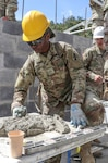 U.S. Army Reserve Pvt. Zakiya Magid, a supply specialist from Bronx, New York, with the 358th Engineer Company, prepares mortar for a cinder block wall during the construction of a medical clinic June 21 in Tojocaz, Guatemala. The 358th Engineer Co. brought a diverse team including U.S. Army Reserve Soldiers from Haiti, Guatemala, Puerto Rico, Ghana and throughout Pennsylvania to work with Guatemalan partners to build a medical clinic for the people of Tojocaz. (U.S. Army Reserve photo by Master Sgt. Ryan Matson, 652nd Regional Support Group)