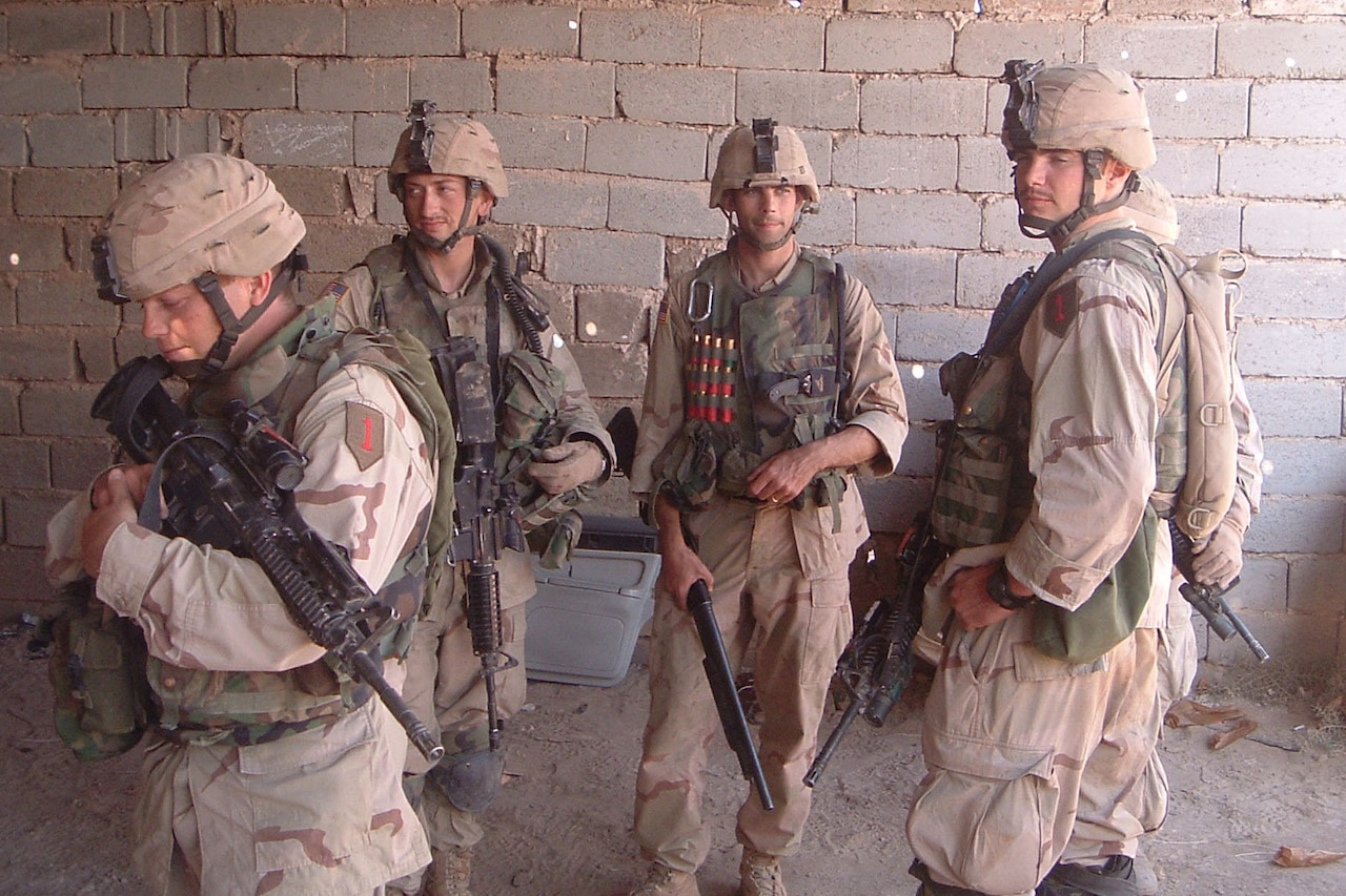 Soldiers pose for a photo.