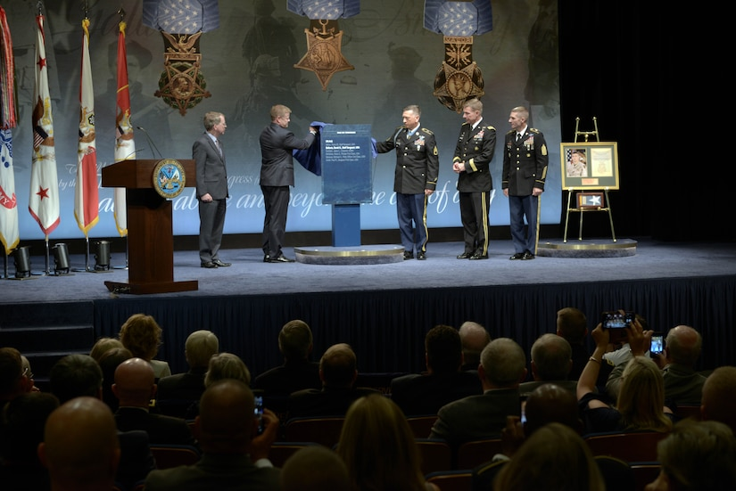 A man is recognized at a ceremony.