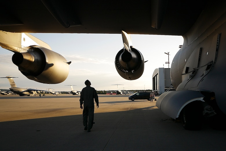 A Hawaii Air National Guard loadmaster assigned to the 204th Airlift Squadron surveys a C-17 Globemaster III June 13, 2019, at Ramstein Air Base, Germany, during exercise Swift Response 19.