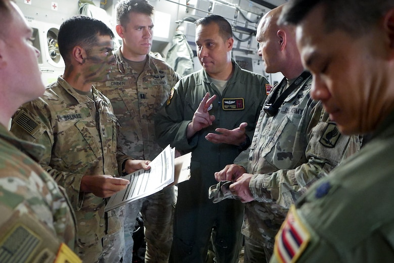 Aircrew assigned to the Hawaii Air National Guard's 204th Airlift Squadron and Soldiers assigned to the 1st Battalion, 143rd Infantry Regiment, 173rd Airborne Brigade, discuss airborne operations on a C-17 Globemaster III June 13, 2019, at Ramstein Air Base, Germany.