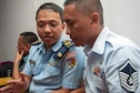 Master Sgt. Bobby-Jo Balmonte 154th Medical Group, Detachment 1 logistics specialist discusses logistical challenges of responding to a pandemic crisis with 1st Lt. Akbar Ikram, flight surgeon with the Tentara Nasional Indonesia during a subject matter expert exchange held Jun. 17, 2019 in Jakarta, Indonesia.