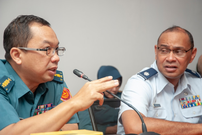 Col. Suswardana from the Tentara Nasional Indonesia Surgeon General Office speaks about pandemic response while Lt. Col. James Faumuina, 154th Medical Group, Detachment 1 commander listens in Jun. 17, 2019, Jakarta, Indonesia.