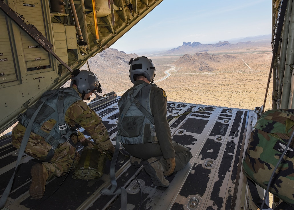 A photo of two airmen in a C-130
