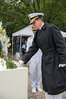 """BUSAN, Republic of Korea (June 26, 2019) Rear Adm. Michael """"Buzz"""" Donnelly, commander, U.S. Naval Forces Korea, places a flower at Gungang Park during a ceremony commemorating the 69th anniversary of the Battle of Daehan Strait. The Battle of Daehan Strait marked the start of the Korean war, when a North Korean troop transport carrying hundreds of troops attempted to land near Busan, but was sunk by a South Korean patrol ship."""
