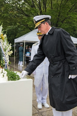 "BUSAN, Republic of Korea (June 26, 2019) Rear Adm. Michael ""Buzz"" Donnelly, commander, U.S. Naval Forces Korea, places a flower at Gungang Park during a ceremony commemorating the 69th anniversary of the Battle of Daehan Strait. The Battle of Daehan Strait marked the start of the Korean war, when a North Korean troop transport carrying hundreds of troops attempted to land near Busan, but was sunk by a South Korean patrol ship."