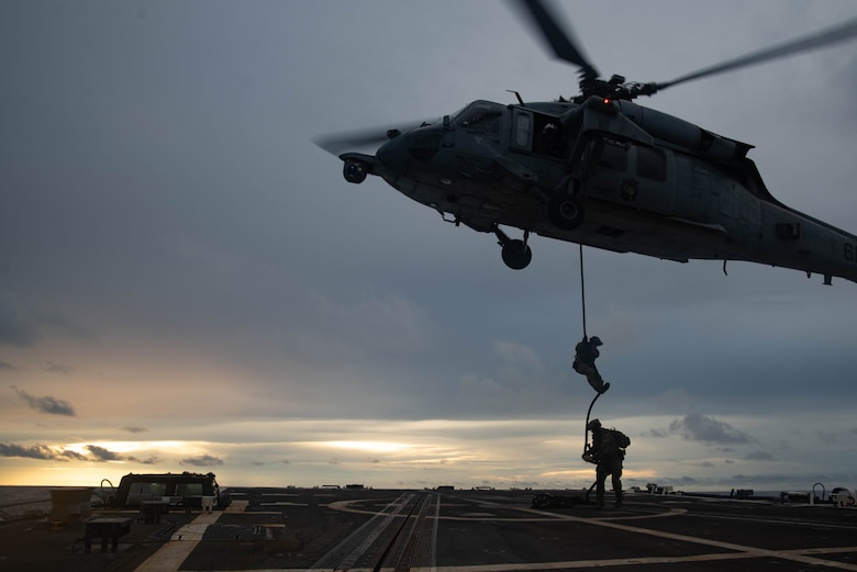 190625-N-RF825-1397 SOUTH CHINA SEA — Sailors from Explosive Ordnance Disposal Mobile Unit 5 attached to Commander Task Force (CTF) 70 conduct Helicopter Vertical Board Search and Seizure (HVBSS) training operations aboard USS McCampbell (DDG 85). CTF 70 is forward-deployed to the U.S. Seventh Fleet area of operations in support of security and stability in the Indo-Pacific Region.