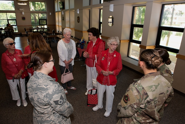 "Team Travis Airmen meet with four ""Rosie the Riveters"" inside the Monarch Dining Facility June 25, 2019, at Travis Air Force Base, California. The Rosies all worked in the Richmond, California, Kaiser Shipyard during World War II. They were at Travis to meet with 60th Air Mobility Wing leadership, have lunch with Airmen and share their experiences. (U.S. Air Force photo by Tech. Sgt. James Hodgman)"