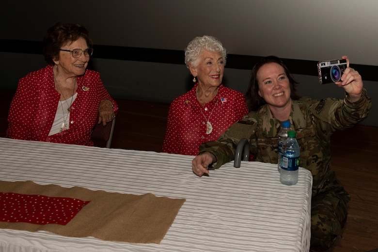 "A U.S. Air Force Airman takes a selfie with Agnes Moore, left, and Kay Morrison, center, after a 'Rosie the Riveter' presentation June 25, 2019, at Travis Air Force Base, California. Moore and Morrison are two of the many women known as ""Rosie"" as they worked as welders in the Richmond, California, Kaiser Shipyard during World War II. During a visit to Travis AFB, the duo joined two other Rosies and met with 60th Air Mobility Wing leadership, had lunch with Airmen and shared their experiences. (U.S. Air Force photo by Tech. Sgt. James Hodgman)"