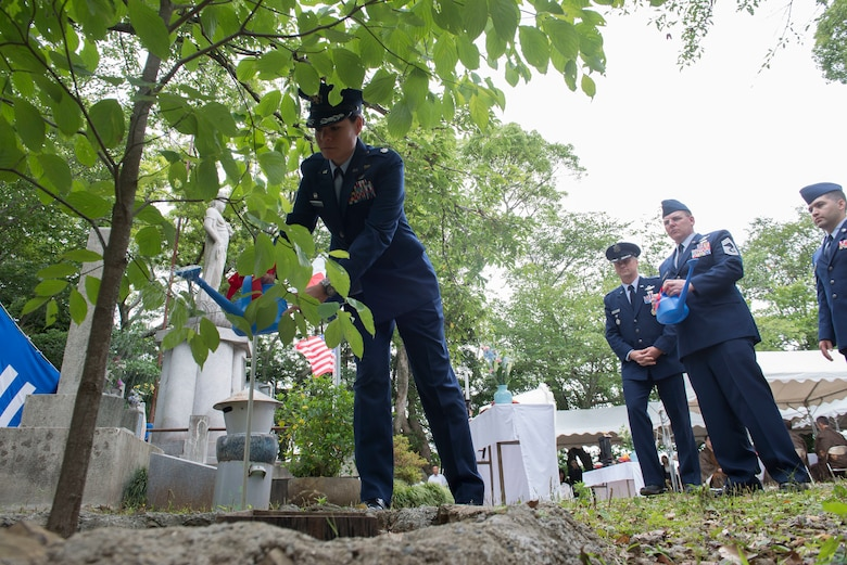 Lt. Col. Cataleya Carlson, 36th Airlift Squadron commander, waters a dogwood tree during the 47th annual B-29 Memorial Ceremony, at Sengen Shrine in Shizuoka City, Japan, June 22, 2019.