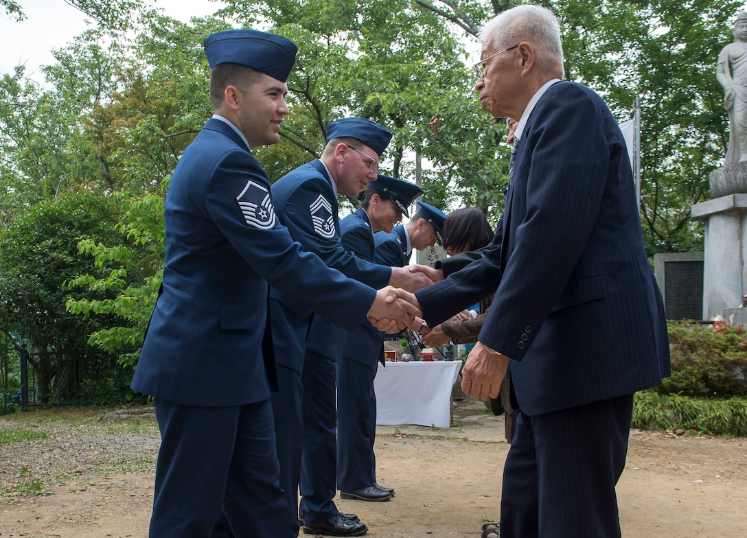 Members of the 374th Airlift Wing, Yokota Air Base, Japan, shake hands with surviving family members of the Japanese Imperial Army during the 47th annual B-29 Memorial Ceremony at Sengen Shrine in Shizuoka City, Japan, June 22, 2019.