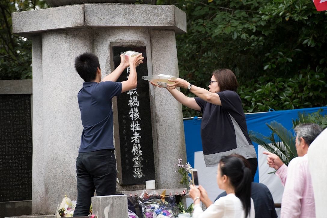 Japanese locals pour sake on the Japanese B-29 memorial monument during the 47th annual B-29 Memorial Ceremony at Sengen Shrine in Shizuoka City, Japan, June 22, 2019.