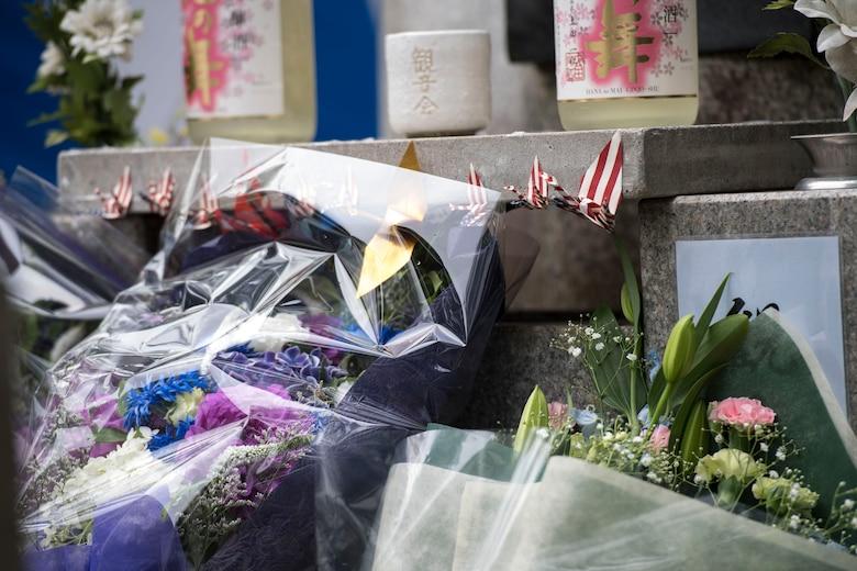 Flowers and Sake rest at the base of the Japanese B-29 memorial monument at Sengen Shrine in Shizuoka City, Japan, June 22, 2019.